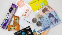 Abbildung Consorsbank, Reiseführer und koreanische Won